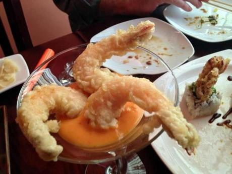 Rock shrimp tempura is served in a martini glass.